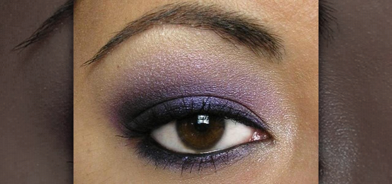 Applying smokey eye makeup