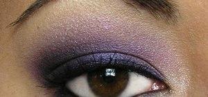 Apply eyeshadow for a purple smokey look
