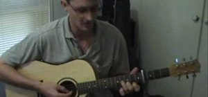"Play ""Sunday Bloody Sunday"" by U2 on acoustic guitar"