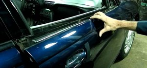 Remove the door lock cylinder and door panel on a Saturn S-series