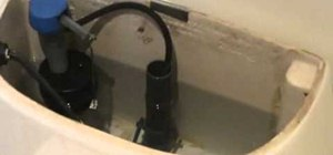 Adjust the float cup/ball height in your toilet tank to save water