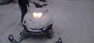 Unload a snowmobile