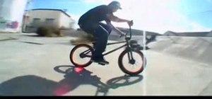 Do a fakie on a BMX