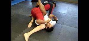 Perform a heel-hooking guard sweep in jiu jitsu