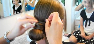 Create a formal hair-wrapped low bun for teens