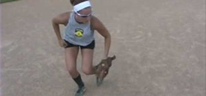 Practice a backhand drill on a softball field