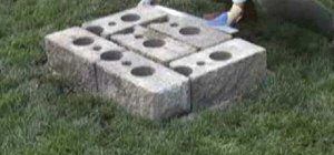 Build a garden bench out of cinder blocks