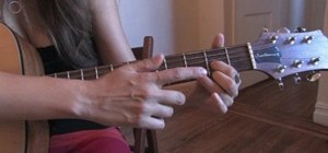 Play simple chords on the acoustic guitar
