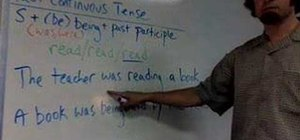 Use the passive voice in past continuous in English