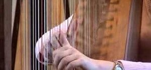 Position your hands for playing the harp