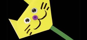Make a googly-eyed paper cat on a popsicle stick