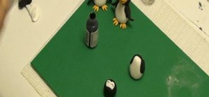 Make a penguin cake topper out of fondant icing