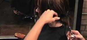 Cut an asymmetrical angled A-line bob hairstyle