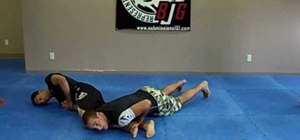 Do a belly down arm bar escape in Jiu Jitsu