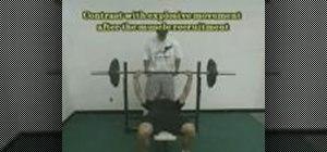 Do a bench press & medicine ball routine for football