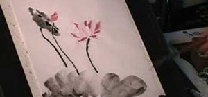 Draw a lotus flower in sumi-e Chinese ink painting