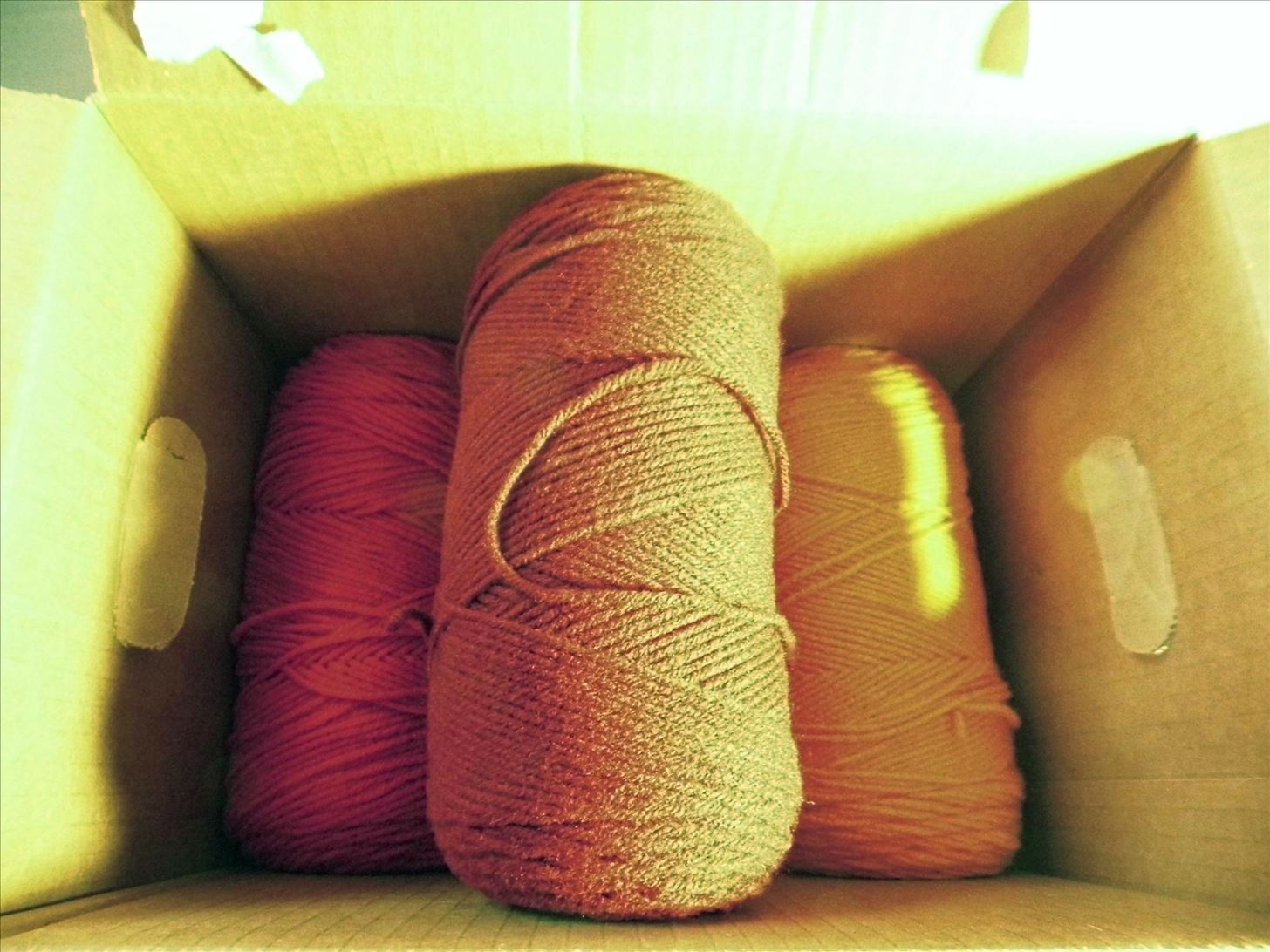 How to Make a Yarn Dispensing Display Out of a Cardboard Box and Dowels