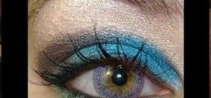 Create an electric blue and violet eye makeup look