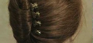 Style your hair in a French roll with bobby pins