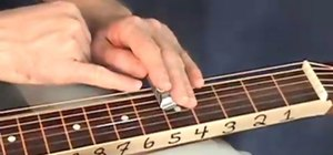 "Play ""Blessed Assurance"" on the lap guitar"