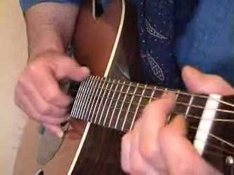 Play a Delta-style blues shuffle on guitar