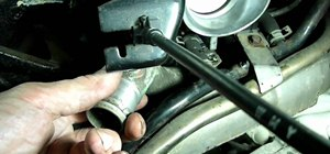 Replace a thermostat on a GM 3.1L or 3.4L automobile