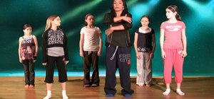 Do a ball, change, step in hip hop dance for kids