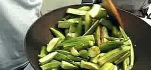 Make dry spicy okra or sukhi bhindi