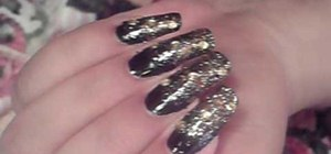 Paint nails with a black and gold fading effect
