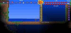 Drain water quickly in Terraria using sand