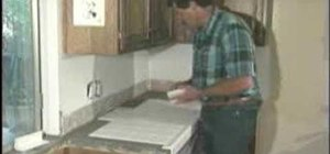 Begin tiling an L-shaped kitchen counter top
