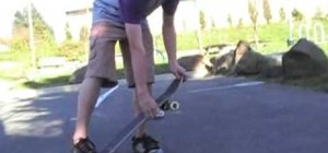 Perform a kickflip on a skateboard