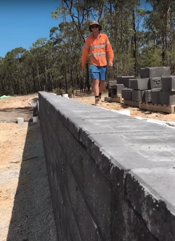Stone Wall Gets Capped Using Perfectly-Aligned Brick Dominoes