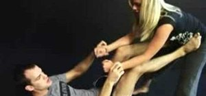 Execute an MMA helicopter armbar with Cole Miller and Joanne of MMA Girls