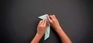 Fold an adorable simple origami parrot