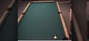 Make a kick shot when the cue ball is frozen to a rail