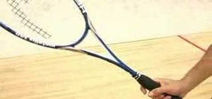 Grip a squash racquet with your thumb and index finger