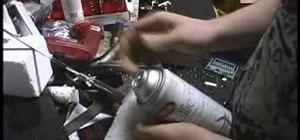 Make an airsoft gun silencer out of a spray can bottle
