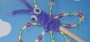Make a garden rainbow butterfly puppet