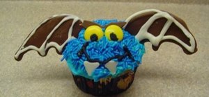 Decorate vampire bat cupcakes for Halloween
