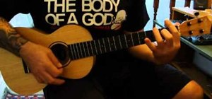 "Play ""No Woman, No Cry"" by Bob Marley on baritone ukulele"
