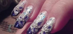 Paint nails with a cobalt blue and pearlescent design