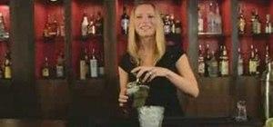 Mix an Amaretto Sour cocktail