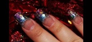 Create a glittery blue and purple acrylic nails
