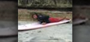 Stand up on a surfboard