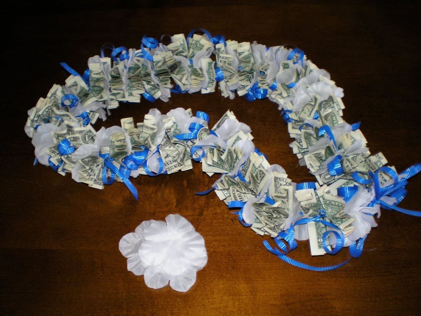 Money origami flower edition 10 different ways to fold a dollar money lei izmirmasajfo
