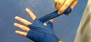 Do an improvised handwrap for boxing