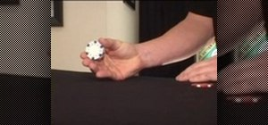 Do the poker chip roll or coin roll trick