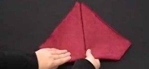 Fold an origami red rosebud napkin design