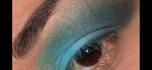 Apply blue-green and yellow glitter eye makeup